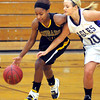 Mankato East point guard Minnie Frederick is the latest Cougars' player to be slowed by injury, playing with ankle and knee problems.