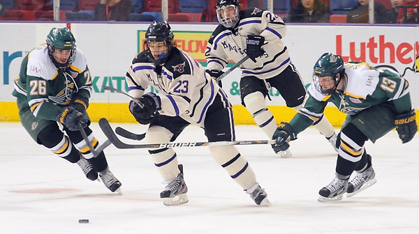 Minnesota State's Teddy Blueger slips between University of Alaska Anchorage's Tyler Currier (26) and Quinn Sproule (13) during the second period Saturday at the Verizon Wireless Center.