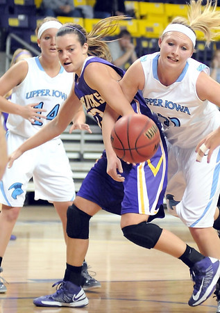 Minnesota State's Jamie Bresnahan and Upper Iowa's Carly Pagel battle for a loose ball under the net during the first half Saturday at Bresnan Arena.