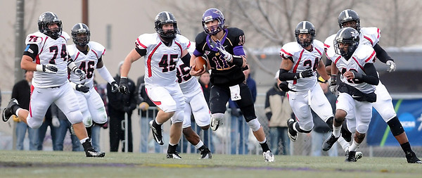 Minnesota State quarterback Jon Wolf outruns a host of Valdosta State defenders during the first half of their NCAA Division II football semifinal game Saturday at Blakeslee Stadium.