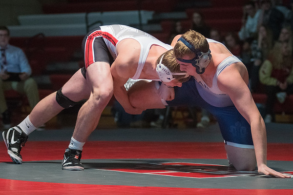 Rylan Moser of Mankato West grabs St. Peter's Hayden Thole's leg in the 220-pound match on Thursday. Moser won by fall in 20 seconds. Photo by Jackson Forderer