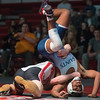 Sage Loredo-Hollon of St. Peter flips out of a hold by Mankato West's Noah Langsjoen in the 170-pound class match on Friday. Loredo-Hollon won the match by decision. St. Peter's Tony Putz won the match for the Saints with a win by fall in the heavyweight match. Photo by Jackson Forderer