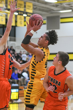 Mankato East's Damani Hayes goes up for a jump shot against Winona's Logan Smith (left) and Dakota Matthees in a Big Nine conference game played on Dec. 8. Photo by Jackson Forderer
