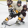 Mankato East's Nick Banfill tries to recover the puck and drive the net against South St. Paul's Owen Ramirez during Saturday's game played at All Seasons Arena. East lost the game 1-0. Photo by Jackson Forderer