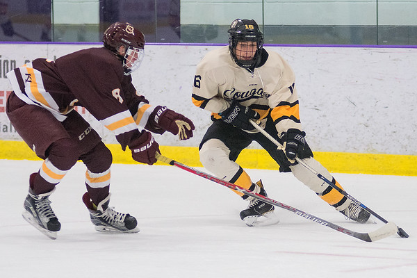 Mankato East's Sam Schulz puts on the brakes and tries to get past South St. Paul's Sam Lehmann during Saturday's game played at All Seasons Arena. The Cougars dropped the game 1-0 to the Packers. Photo by Jackson Forderer