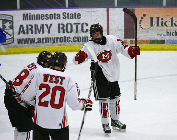 Zachary Erickson (8) of Mankato West celebrates a goal during the second period of Tuesday night's game, against LeSuer-Henderson, with teammates Tyler Loe (18) and Ryan Jutting.