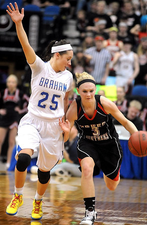 Braham's Rebekah Dahlman tries to slow down New Richland-Hartland-Ellendale-Geneva's Carlie Wagner during their State Class AA quarterfinal game Wednesday at Target Center. Wagner scored a school-record 43 points during their win over Braham.