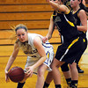 John Cross<br /> Waseeca's Emily Karsten tries to drive the baseline past Mankato East's Taylor Karge during first period action at East High on Monday.