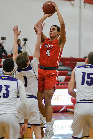 Dondre Spann of Mankato West goes up for a jump shot in a game against Red Wing played on Jan. 12. Photo by Jackson Forderer