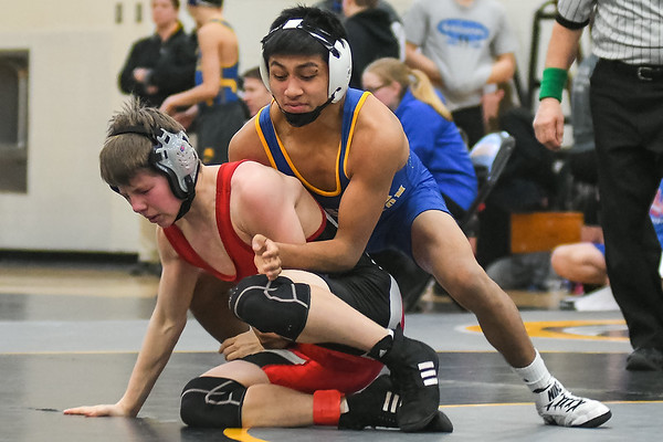 Le Sueur-Henderson's Jorge Hernandez takes down his opponent Zach Smith from Austin in the opening round of the Mankato East Invitational on Saturday. Hernandez  won by a major decision 9-0 over Smith. Photo by Jackson Forderer