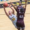 Gustavus' Justine Lee is fouled by Augsburg's Camryn Speese during Wednesday's MIAC conference game played at Gustavus. Photo by Jackson Forderer
