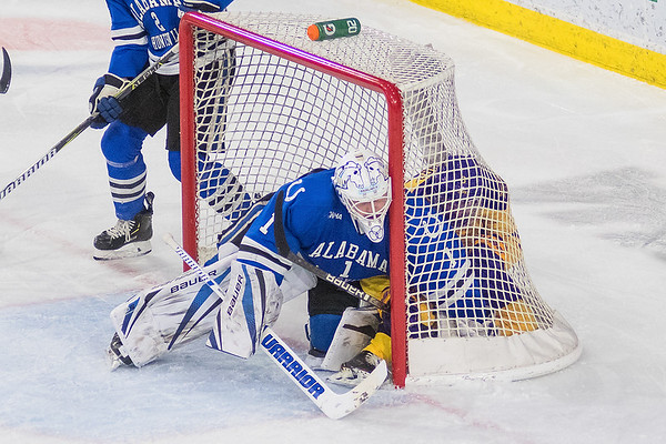 University of Alabama-Huntsville goalie Jake Theut pushes Minnesota State's Charlie Gerard deeper into the net after Gerard crashed the net. Photo by Jackson Forderer