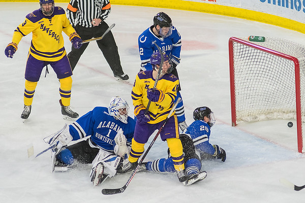 Minnesota State's Reggie Lutz (center) and University of Alabama-Huntsville's Jake Theut (1), Kurt Gosselin (right) and Cam Knight (top) look back to see the puck in the net during the third period as the Mavericks scored a flurry of goals to distance themselves from the Chargers. The Mavericks won 6-1 and will play UAH again tonight. Photo by Jackson Forderer