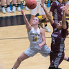 Gustavus' Gabby Bowlin (11) gets past Augsburg's Camille McCoy for a layup in the fourth quarter of Wednesday's MIAC conference game. The Gusties lost 77-68. Photo by Jackson Forderer