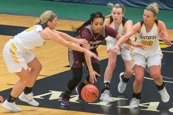 Augsburg's Camille McCoy escapes from defensive pressure from Gustavus players from left, Alison Hinck, Kendall Thompson and Justine Lee in the fourth quarter of Wednesday's game. Photo by Jackson Forderer