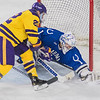 Minnesota State's Dallas Gerads and University of Alabama-Huntsville goalie Jake Theut go after a puck as it slipped by the crease in the third period of Friday's game. Photo by Jackson Forderer
