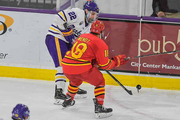 Minnesota State's Dallas Gerads (22) plays the puck along the boards as Ferris State's Hunter Wendt closes in on Gerads in a game played on Nov. 17, 2018. Photo by Jackson Forderer