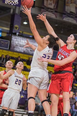 Minnesota State's Tayla Stuttley gets past Moorhead State's Madi Green for a layup in the first half of play. Photo by Jackson Forderer