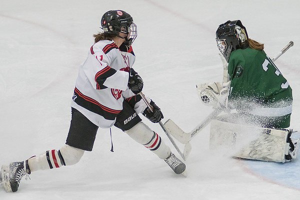 Mankato West's Lindsey Hays (left) watches her shot saved by Faribault goalie Mikayla Bohner during Thursday's game played at All Seasons Arena. Bohner and the Falcons shutout the Scarlets for a 3-0 win. Photo by Jackson Forderer