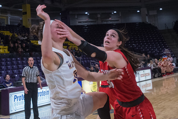Minnesota State's Taylor Drost gets a face full of hands after taking a jump shot against Moorhead State's Brooklyn Liegel in the third quarter during Friday's game played at Bresnan Arena. Drost led all scores with 18 points in the first half. Photo by Jackson Forderer