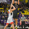 Minnesota State's Cameron Kirksey takes a shot over St. Cloud State's Brindley Theisen in a game played at Bresnan Arena on Jan. 19. Photo by Jackson Forderer