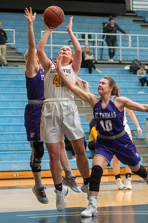 Gustavus' Alison Hinck gets a shot off between St. Thomas' Macy Hatlestad (left) and Lucia Renikoff in the first half of Saturday's MIAC conference game.