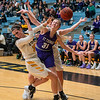 Gustavus' Paige Richert (left) and Alison Hinck (back) cause St. Thomas' Shayla Wallin to lose the ball during Saturday's game at Gustavus. The Gusties lost a nail-biter to the Tommies.
