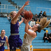 St. Thomas' Macy Hatlestad blocks a shot attempt by Gustavus' Ava Gonsorowski (right) during Saturday's MIAC conference game.