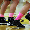 Mankato East and West girls basketball players wear pink socks for cancer awareness during Tuesday's game at the East gym. The two schools raised money for the American Cancer Society during the boys and girls games.