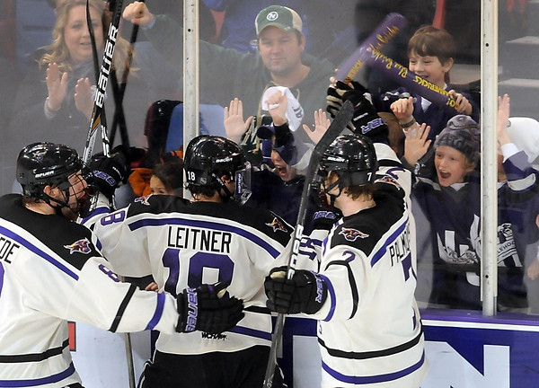 Minnesota State's Matt Leitner celebrates a second period goal with a group of young fans Saturday.