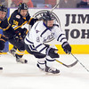 Minnesota State's Max Gaede races ahead of Michigan Tech's Malcolm Gould (22) and C.J. Eick (18) during the first period Friday at the Verizon Wireless Center.