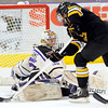 Minnesota State goalie Stephon Williams spins around to stop a shot by Michigan Tech's DAvid Johnstone during the first period Saturday at the Verizon Wireless Center.