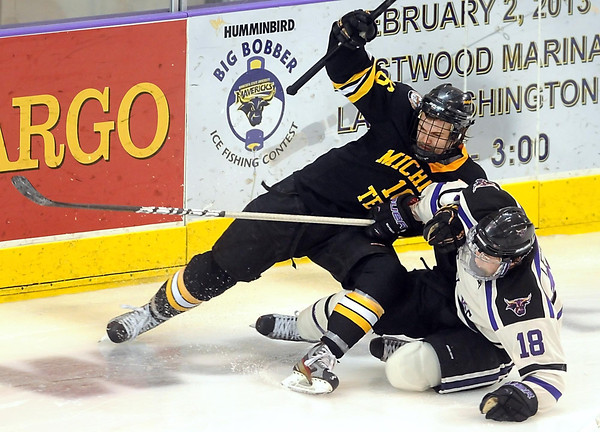 Michigan Tech's Tanner Kero and Minnesota State's Matt Leitner fall to the ice during the second period Saturday at the Verizon Wireless Center.