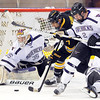Minnesota State's Josh Nelson (2) and goalie Stephon Williams surround Michigan Tech's Jujhar Khaira in front of the net during the first period Friday at the Verizon Wireless Center.
