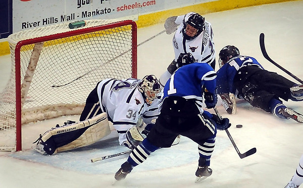 Mzaverick goalie Cole Huggins blocks a shot by Alabama Huntsville's Jack Prince in first period action at the Verizon Wireless Center on Friday.