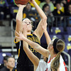 Pat Christman<br /> Mankato East's Claire Ziegler puts up a shot during the second half Tuesday at Bresnan Arena.