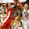 John Cross<br /> Mankato West's Lexi Schoper tries to get a shot past Hutchinson's Madison Christie in firest period action on Saturday.