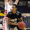 Pat Christman<br /> Mankato West's Carter Burmeister defends Mankato East's Hussein Mohamoud during the first half Tuesday at Bresnan Arena.
