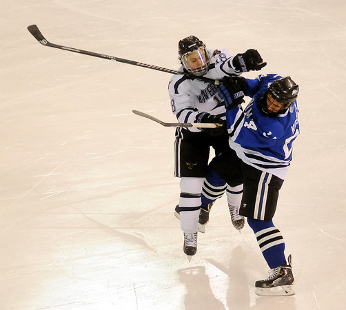 John Cross<br /> Maverick Matt Leitner and Alabama Huntsville's Steven Koshey collide during first period action.