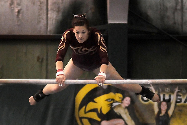 John Cross<br /> Blue Earth Area High School's Haley Resutek performs on the uneven bars.