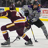 Minnesota State's Daniel Brickley carries the puck into the offensive zone while being defended by University of Minnesota-Duluth's Dylan Samberg in a game played on Jan. 23 at the Verizon Center. Photo by Jackson Forderer