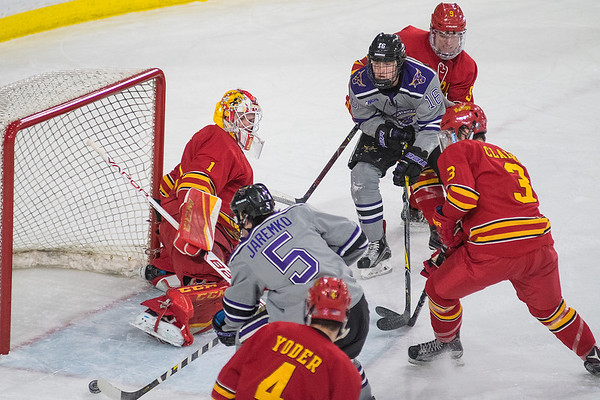 Minnesota State's Jake Jaremko (5) shoots the puck past Ferris State goalie Darren Smith after getting a pass from Reggie Lutz in the second period of Friday's game played at the Verizon Center. The Mavericks offense broke down the Bulldogs defense and scored xxxxxx goals for a xxxx-xxxx win. Photo by Jackson Forderer