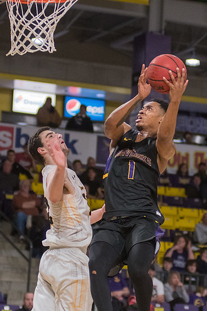 Minnesota State's Jamal Nixon (1) goes up for a shot over Wayne State's Jordan Janssen. The Mavericks won the game 89-78. Photo by Jackson Forderer
