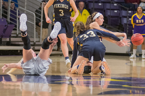 Rylee Menster of Minnesota State tries to pass the ball to a teammate as she and Camryn Hay (33) of Augustana and Brooke Tonsfeldt (left) of Minnesota State scramble for a loose ball. The Mavericks fell to Augustana 77-69. Photo by Jackson Forderer