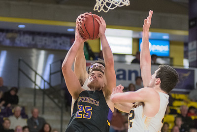 Minnesota State's Kevin Krieger (25) goes up for a shot against Wayne State's Nick Ferrarini (back) and Jordan Janssen (right) during Saturday's game played at Bresnan Arena. Krieger lead the Mavericks in scoring with 24 points. Photo by Jackson Forderer