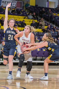 Brooke Tonsfeldt (center) of Minnesota State is defended by Augustana's Hannah Mitby (left) and Danni Honner during the first half of Friday's game played at Bresnan Arena. Photo by Jackson Forderer