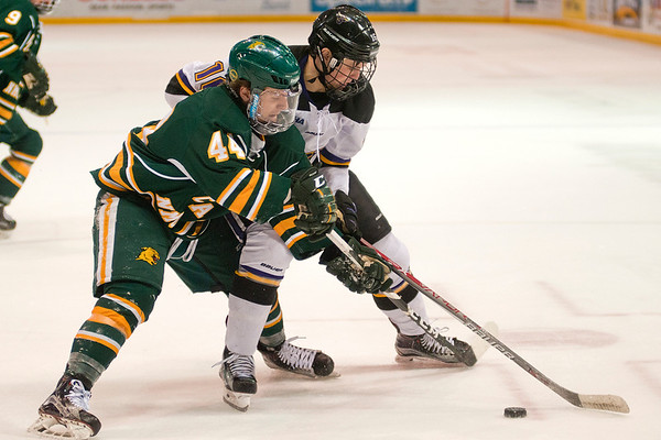 Minnesota State's Jordan Nelson fights for the puck against Northern Michigan's Ryan Black (44) in Saturday's game. The Mavericks won the game 7-4 and have an opportunity to take second place in the WCHA. Photo by Jackson Forderer