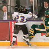 Minnesota State's Nicholas Rivera sends Northern Michigan's Connor Frantti into the air during Saturday's game played at the Verizon Wireless Center. The Mavericks completed the sweep of the Wildcats by winning 7-4. Photo by Jackson Forderer