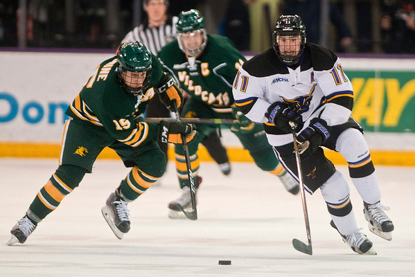 Sean Flanagan (11) of Minnesota State races towards the puck against Northern Michigan's Dominik Shine (15) in the second period of the WCHA conference game played at the Verizon Wireless Center. The Mavericks won the game 5-3 over the Wildcats. Photo by Jackson Forderer