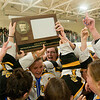 The Mankato East/Loyola girls hockey team hoist their Section 3A first place trophy in the air after defeating Marshall 4-2 on Tuesday in Redwood Falls. The team will open play at the state tournament on Feb. 22 at the Xcel Energy Center in St. Paul. Photo by Jackson Forderer